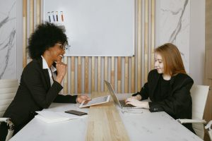 two women meeting at table
